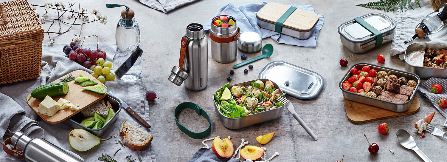 Black+Blum Products including sustainably sourced bamboo lid sandwich box with charcoal filter water bottle and stainless steel salad box